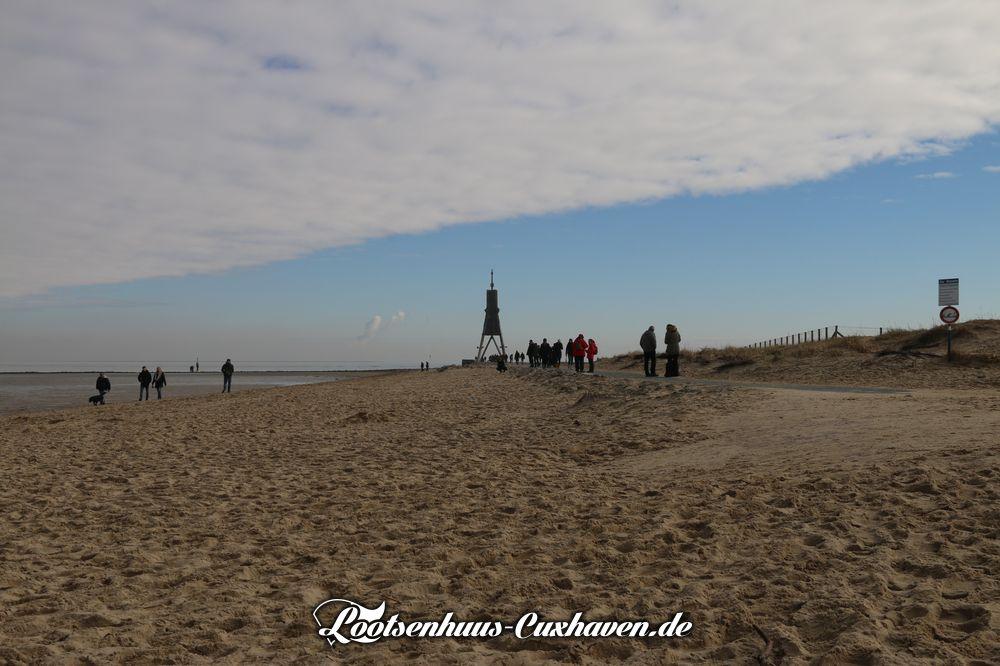 Kugelbake Cuxhaven Winter blauer Himmel Wolken Nordsee